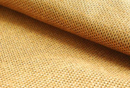 textil: tela de chenilla de color amarillo rojizo agitó fondo de textiles.