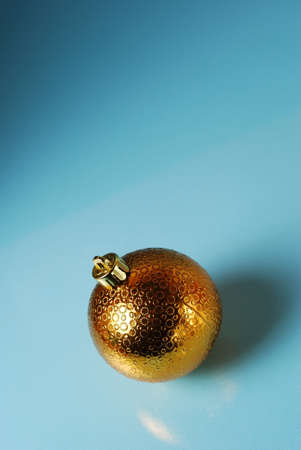 chrom: Golden christmass ball on a blue background. Seasonal background