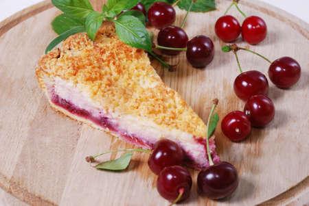 cherry pie: cherry pie slice on a wooden tabke with fresh cherries