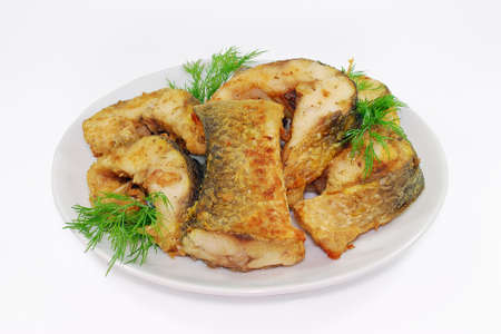 hake: Fried fish, Alaska Pollock or Hake slices on a plate isolated Stock Photo