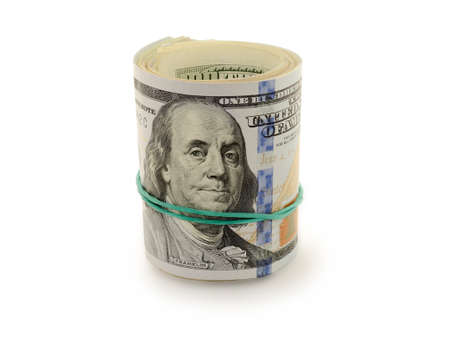bounded: Stack of money dollars bounded by rubber band isolated on a white background Stock Photo