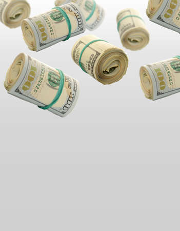 loot: Rolls Of One Hundred Dollar Bills. Abstract money background Stock Photo
