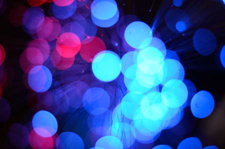 christmas backdrop: Blurred abstract pink and blue bokeh lights. Christmas holiday defocused background. Backdrop for your design