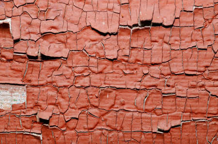 craked: Red Painted old wall. Abstract cracked brown texture. Stock Photo