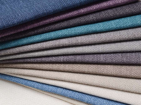 folds: Bright collection of gunny textile samples. Fabric texture background. Stock Photo