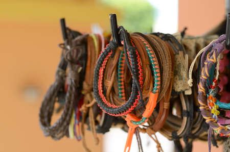 cuff bracelet: Leather bangles on display at local souvenir store
