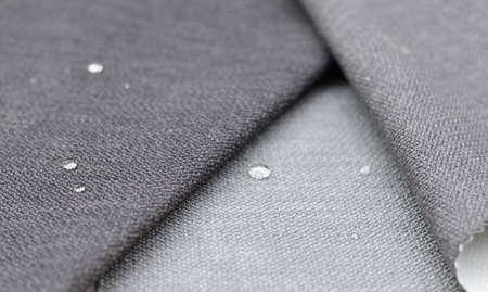 Close up water drop on gunny textile. Concept for easy clean, waterproof surfaces