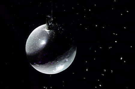 Disco ball on the top of the soffit. Party night background Stock Photo