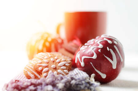 Still life with cup of coffee or cacao, Apples and gingerbread cookies with icing sugar decoration. Christmas and New Year holidays background Stock Photo