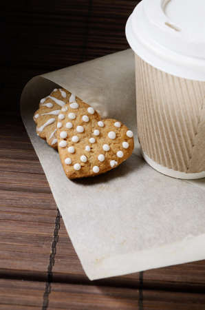 Gingerbread cookies and cup of coffee to go.
