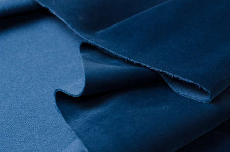 Bright blue velour textile. Fabric texture background