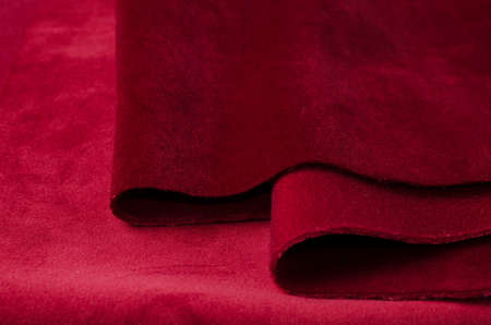 Bright red velour textile samples. Fabric texture background