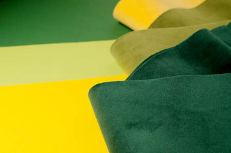 Trendy green and yellow velour textile samples. Fashion Fabric background