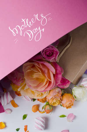 Live roses frame. Beautiful floral background. Card Template to spring holidays with creative space for text. Stock Photo