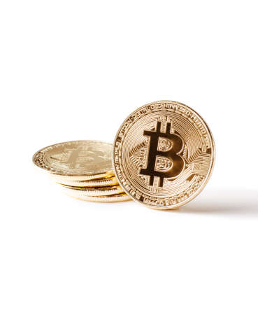 Physical Gold Bitcoin Coin on a white background. New independed worldwide cryptocurrency.