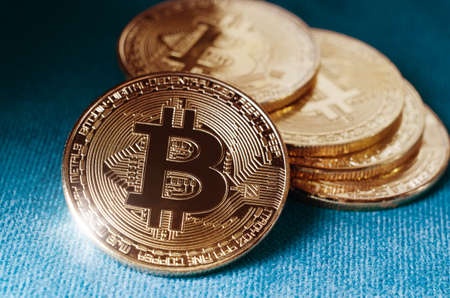 Physical Gold Bitcoin Coin. Buisness and financial background Stock Photo