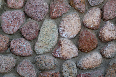 Beige and pink stones at the wall. Stone texture background.