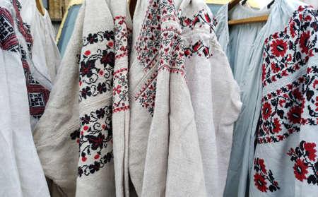 Old, vintage embroidered shirts at the flea market, Ukraine, Kiev. Stock Photo