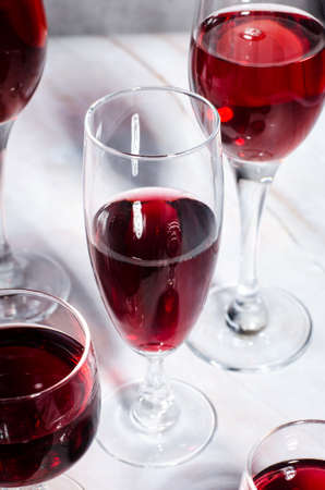 Wine card. Goblets with red and white whine.