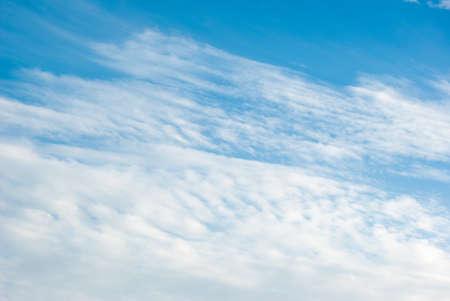 Beautiful cumulus clouds in a blue summer sky