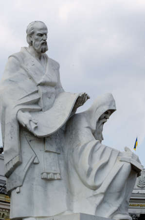 Kyiv Ukraine - June 22, 2019. Monuments to Cyril and Methodius, one part of monumet to Olgha the Princess of Kyiv Russ, Apostle Andrew, in Kyiv, Mikhaylovskaya Square. 新聞圖片