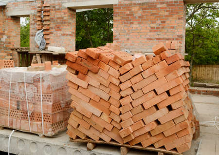 Stack of bricks on the construction territory Stock Photo