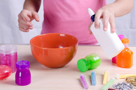 Slime making process. Kid making slime, worldwide popular self made toy.
