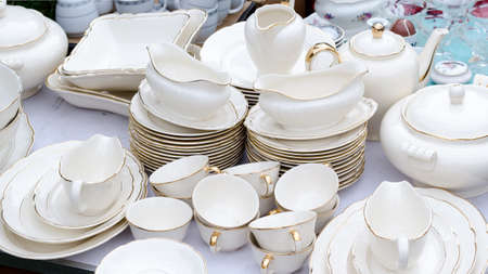 Wroclaw, Poland - 01.12.2019: huge white porcelain set on the Flea Market in Wroclaw, Poland.