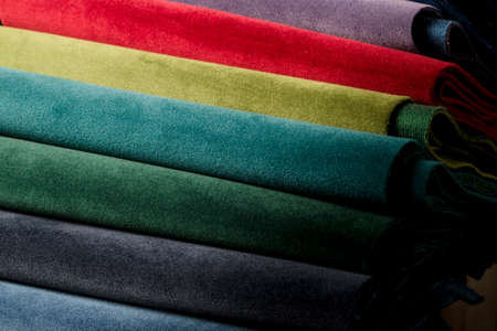 Bright collection of colorful velor textile samples. Fabric texture background