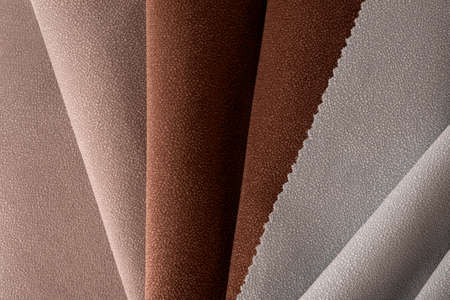 Light Set Sail Champagne and chocolate colors velor textile samples. Fabric texture background