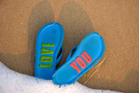 slippers on beach photo