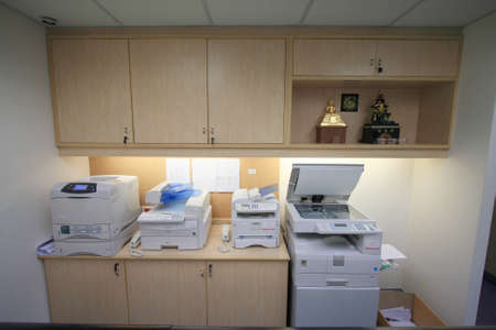 scan paper: office interior with printer, fax and photocopier