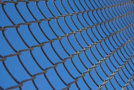 metal wire: close up of metal wire mesh in blue sky