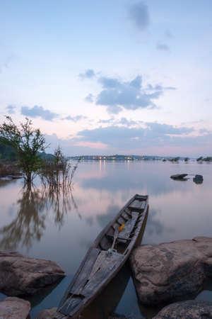 tranquillity: boat in khong river after sunset,  khong chiam, Ubon Ratchathani, Thailand Stock Photo
