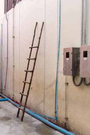 breaker: wooden ladder on wall near  breaker box