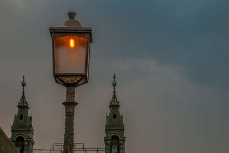 Lamp on the Hammersmith Bridge in west London. The first suspension bridge over the River Thames from Hammersmith to Barnes