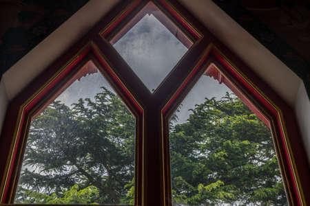 The window that receives light is inside the Thai temple church, Sunlight through the church window