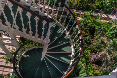 A Spiral staircase in a beautiful flower garden.