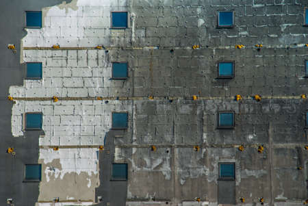 The pattern on the side of the old building that is about to be dropped Suitable for background images. Stockfoto - 123248732