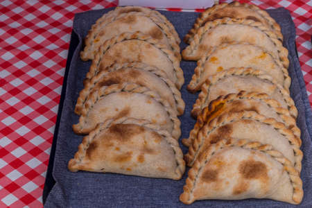Traditional Vegetarian Empanadas stuffed with Cheese and Tomato.