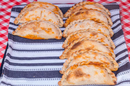 Traditional baked Empanadas stuffed with Chicken and Chorizo. Stock Photo - 124363305