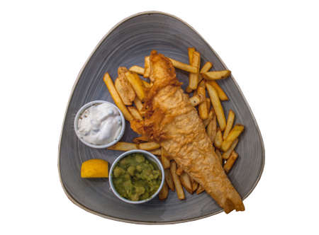 British Traditional Fish and chips with mashed peas, tartar sauce. isolated on white background. Free space for your text.