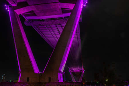 Under a bridge a pier, a landing architecture infrastructure - Bhumibol Bridge foundation post, foundation pillar abutment which is a v-shaped, gives a sense of victory.