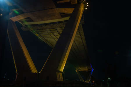 Under a bridge a pier, a landing architecture infrastructure - Bhumibol Bridge foundation post, foundation pillar abutment which is a v-shaped, gives a sense of victory. Banco de Imagens - 128031680