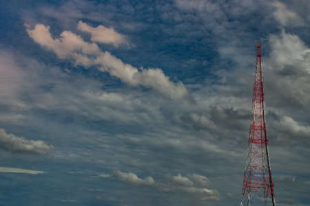 Silhouettes Telecommunication tower with there is a backdrop of beautiful sky and clouds. copy space.