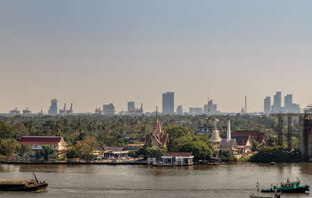 Bangkok, Thailand - Jan 04, 2020 : The view of the Chao Phraya River that sees Wat Bangkrachaonok and the green area next to the river, which is called Bang Krachao, Beautiful nature.