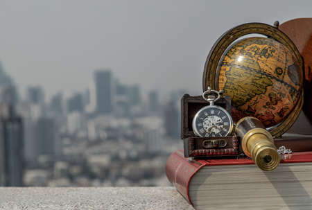 Travel or adventure concept background. Pocket watch, binoculars, book, globe with a sky background. Journey Concept, Copy Space, Vintage Style.