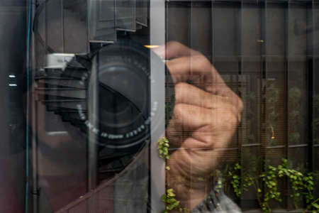 View reflection In mirror while photographing. Camera lens close-up background. No focus, specifically. 版權商用圖片