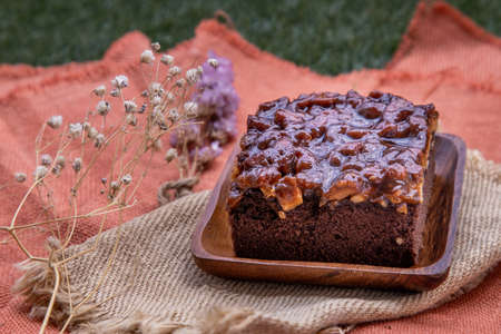Traditional homemade sweet bread : Walnut toffee cake with caramel on beautiful background. One piece, Selective focus. Stok Fotoğraf