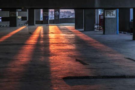 Empty car parking interior at evening. Parking garage lot, No focus, specifically. Фото со стока
